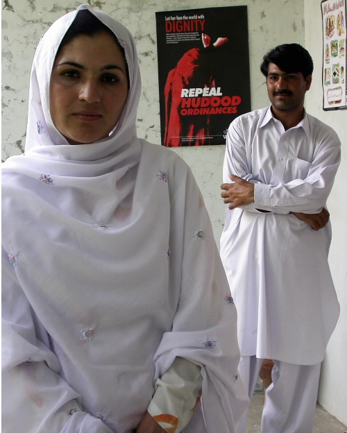 ZIARAT TALASH, Pakistan (Aug. 8, 2005) -- Shad Begum, left, leads a campaign by women in Pakistan's conservative Dir Valley to enforce laws allowing women to vote and run for office. Her brother, Mohammed, right, has had his home and pharmacy stoned by residents who oppose his sister.  Many in the valley say any public role for women -- even leaving the house to cast a vote -- violates Islam.